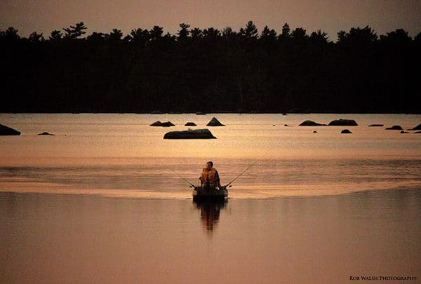 Photo of two people fishing in a boat on Rocky Lake